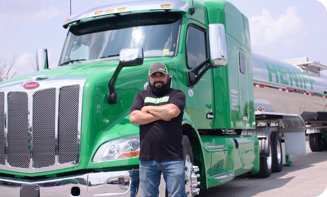 Man with t-shirt in front of his semi-truck
